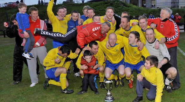 Winning feeling: Derriaghy players celebrate their Clarence Cup win after a penalty shoot-out