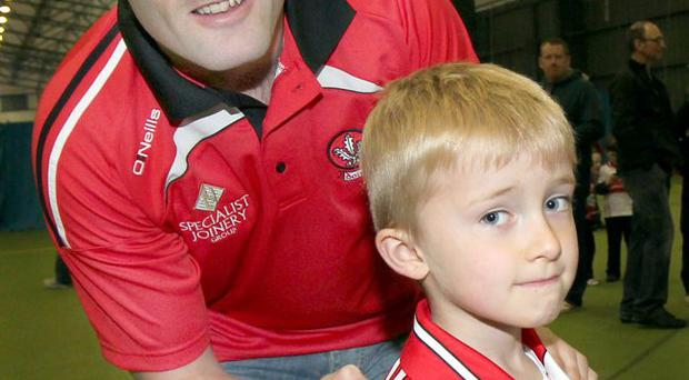 Back line: Derry skipper Paddy Bradley obliges a young fan with an autograph at the team's Open Night