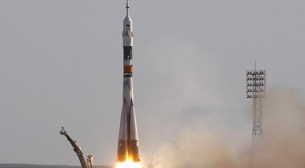 A Soyuz craft blasts off with a new crew for the International Space Station (AP)
