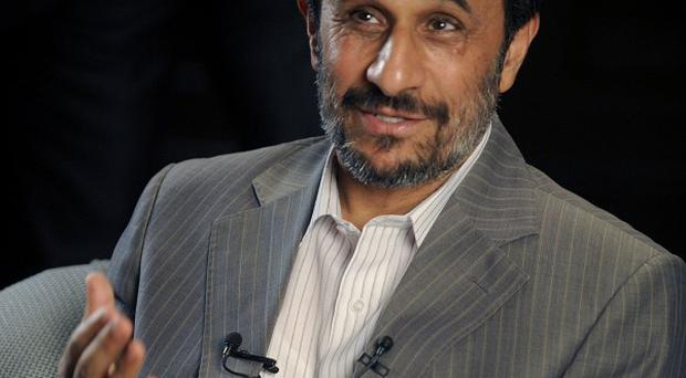 Iranian President Mahmoud Ahmadinejad claims he is not welcome at the London Olympics (AP)