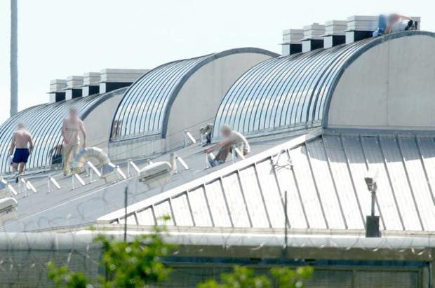 Protesting in the sun: prisoners on the roof of Maghaberry Prison in 2003