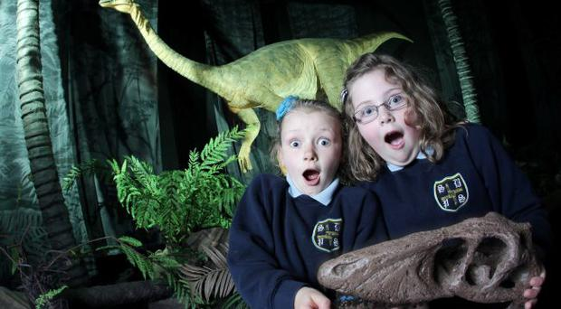 Fearsome fun: Aine Magill and Emma Gregg, from St Brigid's Primary School, Cloughmills at the Age Of The Dinosaur exhibition