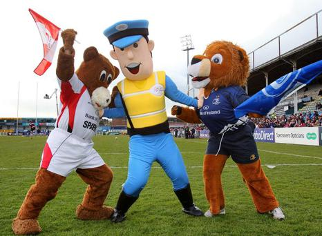 Middle man: Emergency Eddie, mascot of the World Police and Fire Games 2013 keeps the peace between Ulster Rugby's mascot Sparky and Leinster's Leo