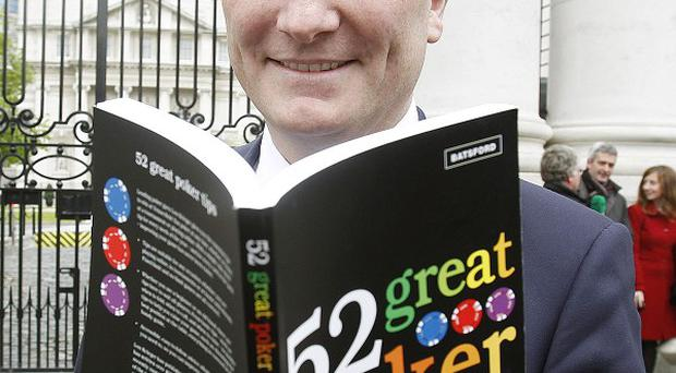 Declan Ganley delivers a book on playing poker to Enda Kenny as part of his campaign calling for a no vote on the fiscal treaty