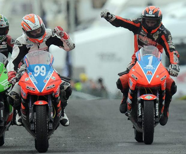 Full throttle: Ryan Farquhar (1) and Jeremy McWilliams (99) celebrate crossing the line first and second in the Supertwins race