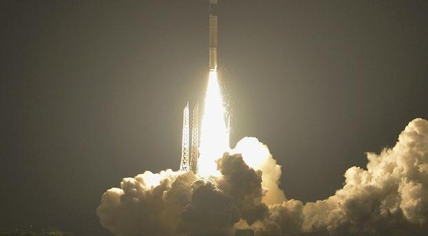 A H-2A rocket lifts off from the Japan Aerospace Exploration Agency's Tanegashima Space Centre (AP Photo/Kyodo News)