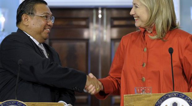 US Secretary of State Hillary shakes hands with Burma's Foreign Minister Wunna Maung Lwin in Washington (AP)