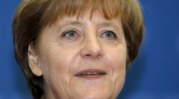 Angela Merkel has suggested that Greece should hold a referendum on the euro