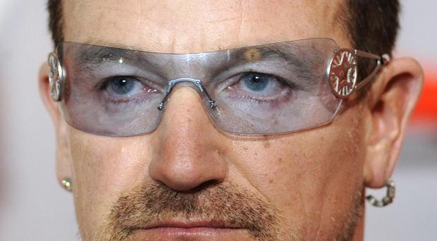Bono's investment group Elevation put money into social networking site Facebook