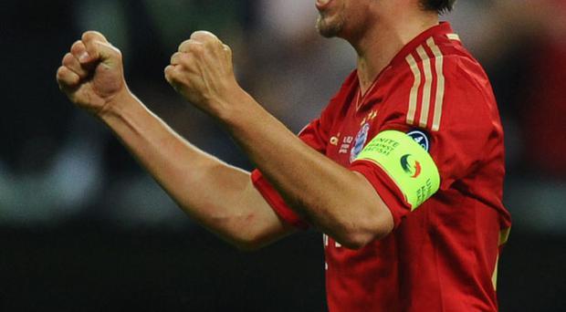 MUNICH, GERMANY - MAY 19: Philipp Lahm of Bayern Muenchen celebrates after Thomas Mueller scored the opening goal during UEFA Champions League Final between FC Bayern Muenchen and Chelsea at the Fussball Arena München on May 19, 2012 in Munich, Germany. (Photo by Mike Hewitt/Getty Images)
