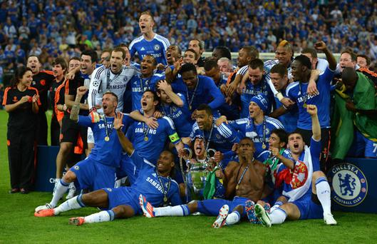MUNICH, GERMANY - MAY 19: Chelsea players celebrate with the trophy after their victory in the UEFA Champions League Final between FC Bayern Muenchen and Chelsea at the Fussball Arena München on May 19, 2012 in Munich, Germany. (Photo by Lars Baron/Bongarts/Getty Images)