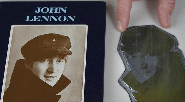 A printers' plate of John Lennon alongside the book In His Own Write