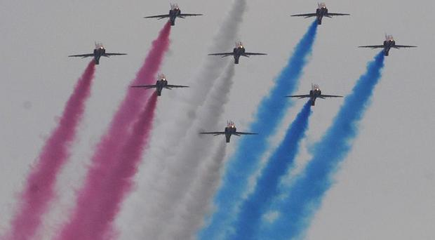 The Red Arrows fly past during the Queen's Diamond Jubilee Armed Forces Parade and Muster in Windsor, Berkshire