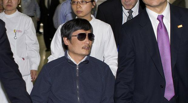 Blind activist Chen Guangcheng is flying to the US (AP)