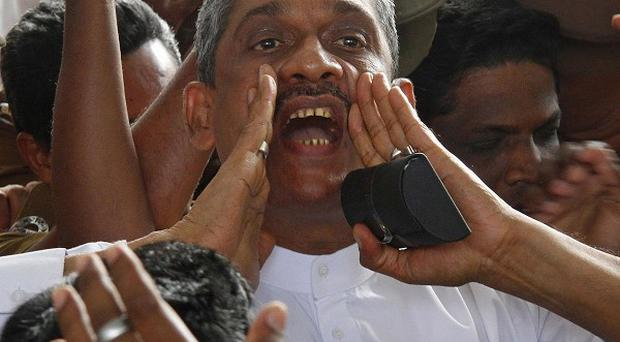 Defeated presidential candidate and former army chief Sarath Fonsekahas been released (AP Photo)