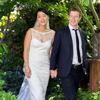 Facebook founder Mark Zuckerberg and Priscilla Chan at their wedding ceremony in California (AP Photo/Facebook, Allyson Magda Photography)
