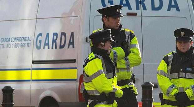 A man is being questioned after a woman died after being found injured in a Dublin flat