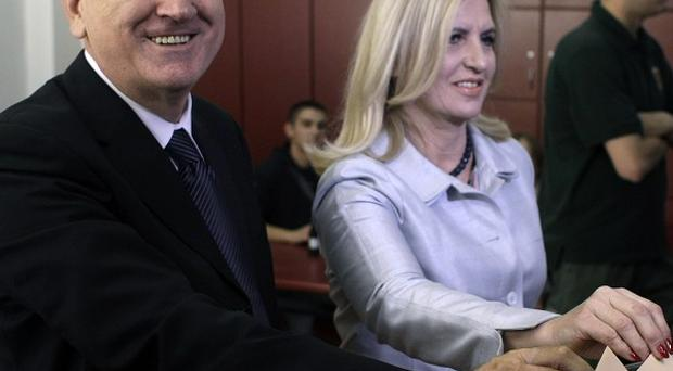 Tomislav Nikolic and his wife, Dragica cast their ballots in the presidential run-off elections in Belgrade, Serbia (AP)