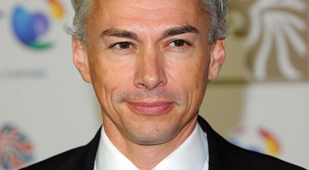 Jonathan Edwards will carry the Olympic Torch