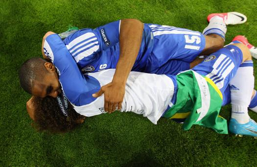 MUNICH, GERMANY - MAY 19: Florent Malouda and David Luiz of Chelsea celebrate after their victory in the UEFA Champions League Final between FC Bayern Muenchen and Chelsea at the Fussball Arena München on May 19, 2012 in Munich, Germany. (Photo by Alex Livesey/Getty Images)