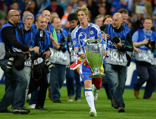 MUNICH, GERMANY - MAY 19: Fernando Torres of Chelsea celebrates with the trophy after their victory in the UEFA Champions League Final between FC Bayern Muenchen and Chelsea at the Fussball Arena München on May 19, 2012 in Munich, Germany. (Photo by Lars Baron/Bongarts/Getty Images)