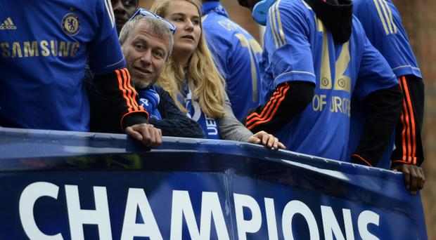 Chelsea owner Roman Abramovich on the team bus during the FA Cup and UEFA Champions League trophy parade in London