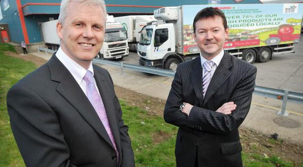 Paddy Doody (left), sales and marketing director of Henderson Wholesale, and Ron Whitten (right), Henderson Group finance director, at the group's Mallusk headquarters