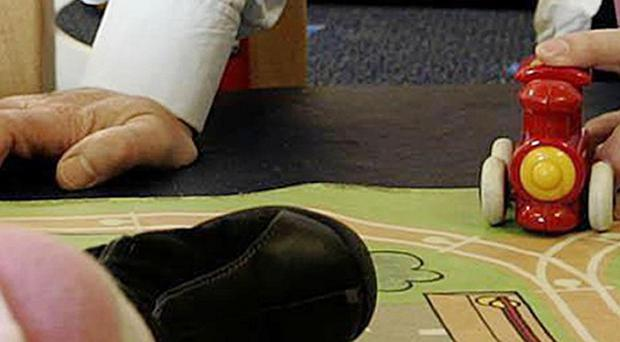 MPs say some families are being denied access to free nursery education unless they pay compulsory 'top-up' fees