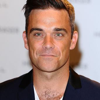 Robbie Williams is being tipped to be a guest judge at The X Factor auditions
