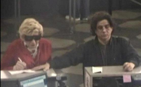 This May 2009 photo from video provided by the Brooklyn District Attorney's office shows, according to prosecutors, Thomas Parkin, 49, at left, on a Department of Motor Vehicles security camera, dressed up as his mother, who died in 2003, as part of a scam to collect her government benefits.