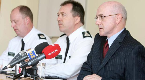 Assistant Chief Constable George Hamilton, Chief Constable Matt Baggott and chair of the Victims' Commission Brendan McAllister at Monday's Press conference