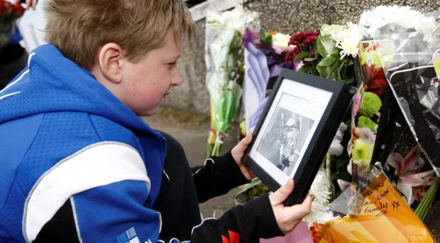 Jordan Harron pays his respects to biker Mark Buckley who died at the North West 200 over the weekend