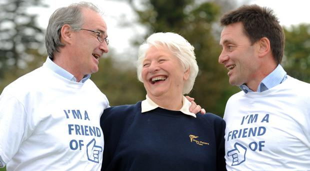 Former Mary Peters Trust award winners Paul Lawther (left) and Ian Corry join Dame Mary in launching the Friends of Mary Peters Association