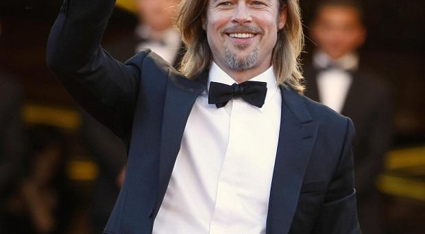 Brad Pitt waves as he arrives for the screening of Killing Them Softly at the 65th international film festival in Cannes (AP)