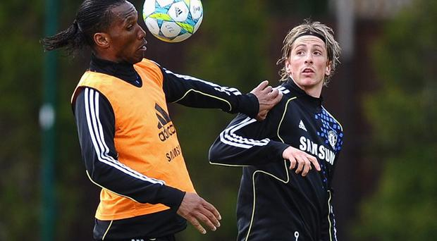 Didier Drogba (left) has backed Fernando Torres to improve at Chelsea