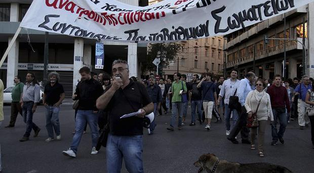 Anti-austerity protesters march through central Athens (AP)