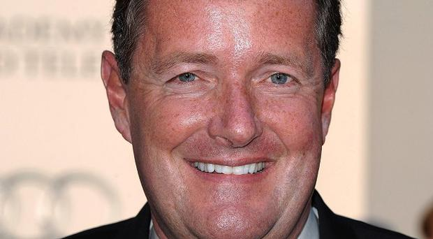 Piers Morgan showed Jeremy Paxman how to access other people's voicemail messages, says the Newsnight presenter