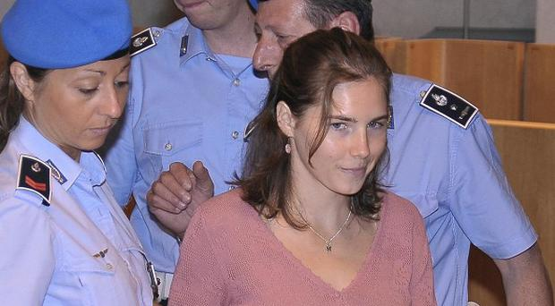 American student Amanda Knox arriving for a hearing of her murder appeal trial in Perugia, Italy in 2011 (AP)