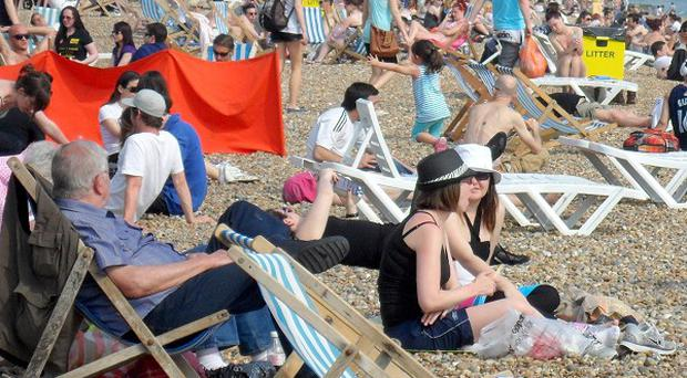 People enjoy the warm weather on Brighton beach