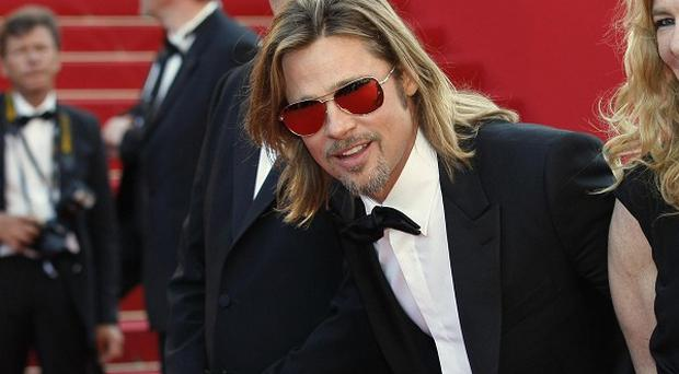 Brad Pitt signed autographs as he attended the premiere of his new film