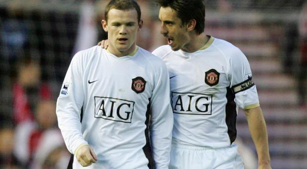Gary Neville (right) was Wayne Rooney's team-mate at Manchester United and England