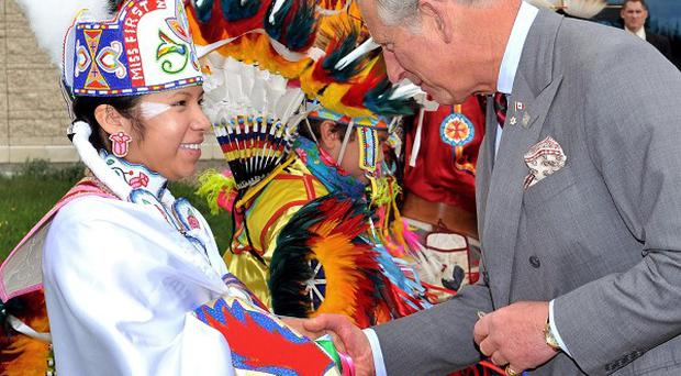 The Prince of Wales with traditional dancers at the First Nations University, in Regina, Canada