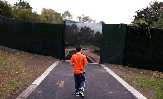 Shared future? a boy walks towards an opened peace wall in Alexandra Park; below, Alliance leader David Ford has left CSI talks