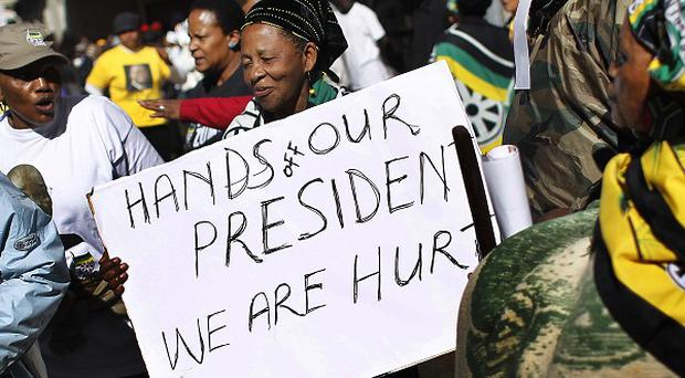 Supporters of South African President Jacob Zuma gather outside court (AP)