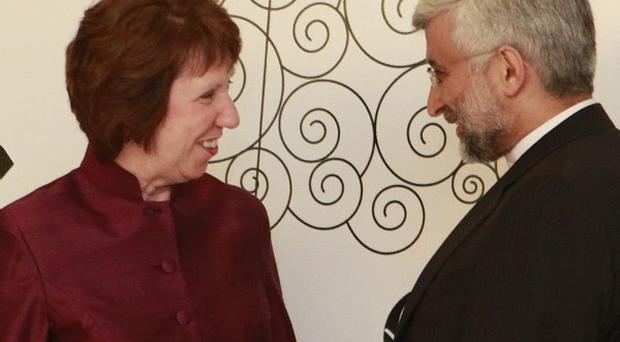 Iran's chief nuclear negotiator Saeed Jalili chats with EU foreign policy chief Catherine Ashton in Baghdad, Iraq (AP)