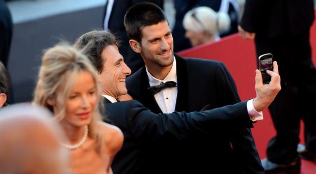 CANNES, FRANCE - MAY 22: tennis player Novak Djokovic attends the 'Killing Them Softly' Premiere during 65th Annual Cannes Film Festival at Palais des Festivals on May 22, 2012 in Cannes, France. (Photo by Michael Buckner/Getty Images)