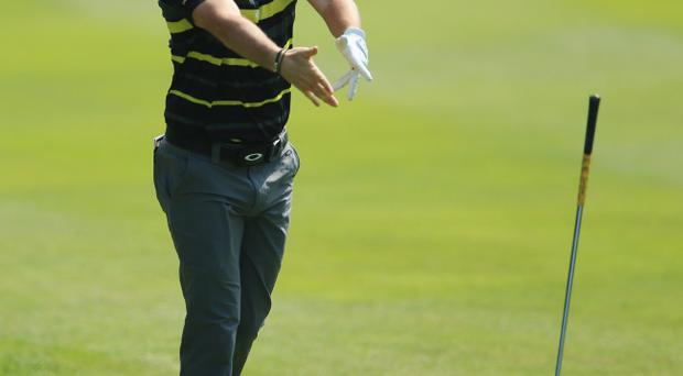 Rory McIlroy of Northern Ireland throws his club after hitting his 4th shot on the 12th hole during the first round of the BMW PGA Championship on the West Course at Wentworth on May 24, 2012 in Virginia Water, England