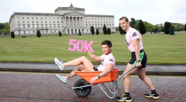 The Big Push for Freedom! Pictured is Glenn Wilkinson from Belfast and Scott McGarry fromCullybackey who have set themselves a record breaking challenge to push each other the length and breadth of Northern Ireland in a wheel barrow to help raise £50,000 for Freedom House
