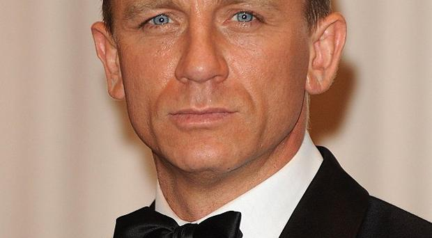 Daniel Craig's suave look as 007 has seen him voted snappiest movie dresser by film fans
