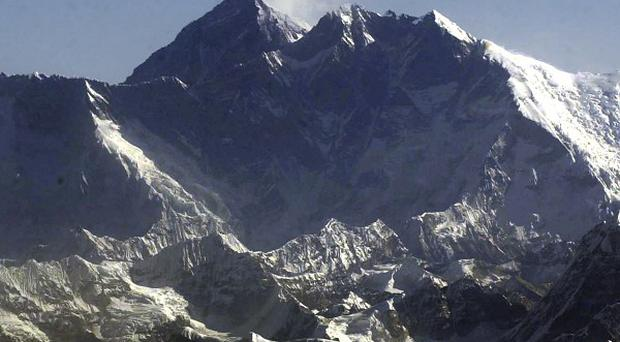 Mountaineers are racing to reach the summit of Everest as the climbing season nears its end